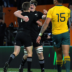 Beauden Barrett (left) is congratulated by brother Scott after scoring the matchwinner, as Wallaby Israel Folau (15) looks on during the Rugby Championship and Bledisloe Cup rugby match between the New Zealand All Blacks and Australia Wallabies at Forsyth Barr Stadium in Dunedin, New Zealand on Saturday, 26 August 2017. Photo: Dave Lintott / lintottphoto.co.nz