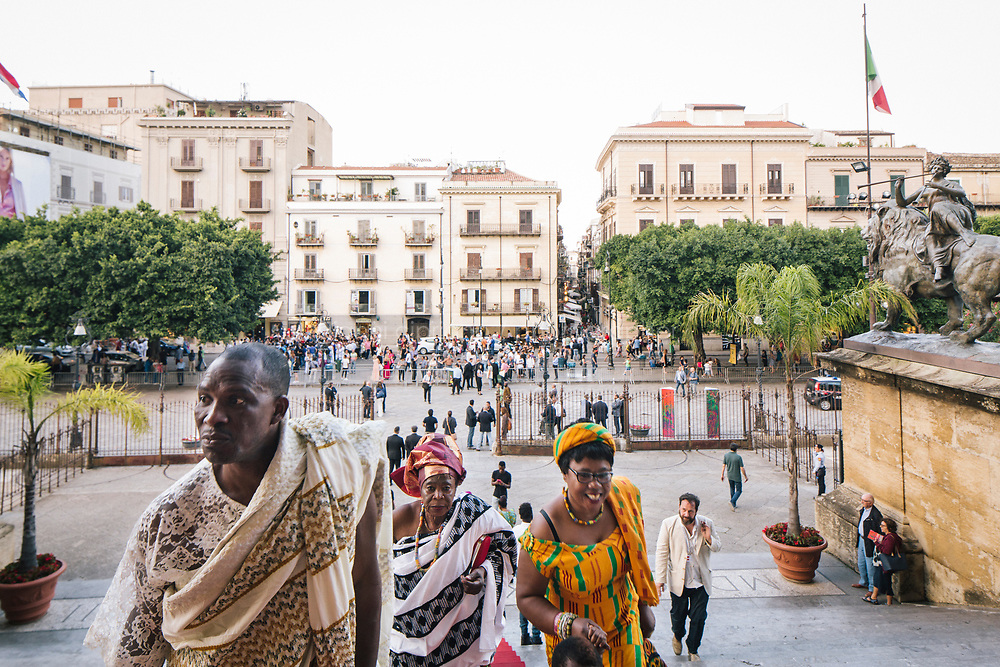 PALERMO, ITALY - 15 JUNE 2018: Visitors and artists arrive at the Teatro Massimo for Bintou W&eacute;r&eacute;'s &quot;A Sahel Opera&quot;, during Manifesta 12, the European nomadic art biennal, in Palermo, Italy, on June 15th 2018.<br /> <br /> Manifesta is the European Nomadic Biennial, held in a different host city every two years. It is a major international art event, attracting visitors from all over the world. Manifesta was founded in Amsterdam in the early 1990s as a European biennial of contemporary art striving to enhance artistic and cultural exchanges after the end of Cold War. In the next decade, Manifesta will focus on evolving from an art exhibition into an interdisciplinary platform for social change, introducing holistic urban research and legacy-oriented programming as the core of its model.<br /> Manifesta is still run by its original founder, Dutch historian Hedwig Fijen, and managed by a permanent team of international specialists.<br /> <br /> The City of Palermo was important for Manifesta&rsquo;s selection board for its representation of two important themes that identify contemporary Europe: migration and climate change and how these issues impact our cities.