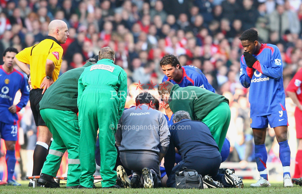 LIVERPOOL, ENGLAND - SATURDAY, FEBRUARY 18th, 2006: Manchester United's Alan Smith receives treatment for a broken leg  as concerned players look on during the FA Cup 5th Round match against Liverpool at Anfield. (Pic by David Rawcliffe/Propaganda)