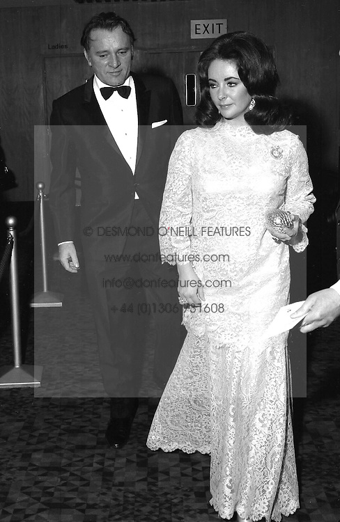 RICHARD BURTON and ELIZABETH TAYLOR at a film premier in London's Leicester Square on 11th April 1968.