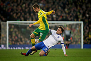 Portsmouth midfielder Ben Thompson (32) tackles Norwich City forward Dennis Srbeny during the The FA Cup 3rd round match between Norwich City and Portsmouth at Carrow Road, Norwich, England on 5 January 2019.