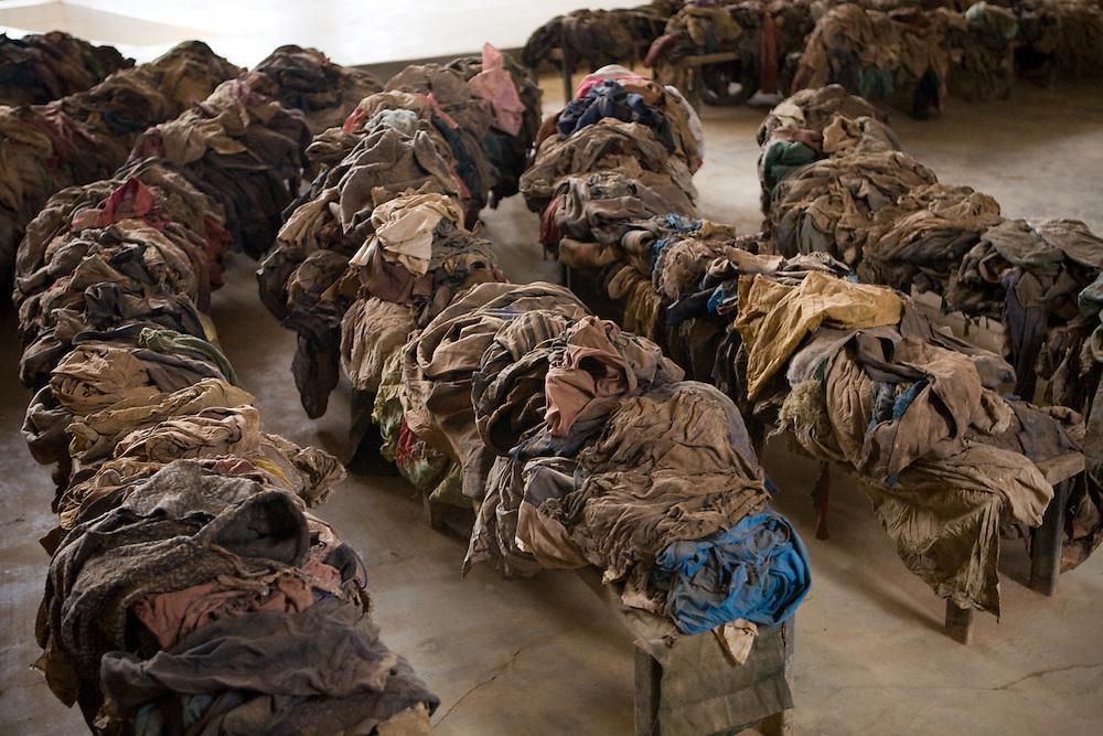 Bloodstained clothing of massacre victims on pews of Nyamata Church, Rwanda Genocide