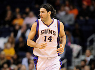 Dec. 09, 2012; Phoenix, AZ, USA; Phoenix Suns forward Luis Scola (14) runs up the court the game against the Orlando Magic in the first half at US Airways Center. Mandatory Credit: Jennifer Stewart-USA TODAY Sports