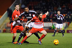 Leyton Orient Midfielder Romain Vincelot (FRA) is challenged by Bristol City Midfielder Jay Emmanuel-Thomas (ENG) - Photo mandatory by-line: Rogan Thomson/JMP - 07966 386802 - 11/02/2014 - SPORT - FOOTBALL - The Matchroom Stadium, London - Leyton Orient v Bristol City - Sky Bet Football League 1.