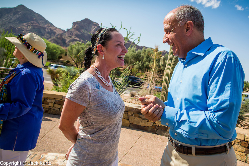 29 AUGUST 2012 - PARADISE VALLEY, AZ:   Dr. RICHARD CARMONA, Democratic candidate for US Senate from Arizona, talks to CC GOLDWATER after a press conference in Barry Goldwater Memorial Park in Paradise Valley, AZ, Wednesday. Carmona won the endorsements of Joanne Goldwater, daughter of Barry Goldwater, the late legendary Republican Senator from Arizona. He was also endorsed by CC Goldwater, her daughter, and Tyler Ross Goldwater, CC Goldwater's son. Barry Goldwater was from Paradise Valley.   PHOTO BY JACK KURTZ