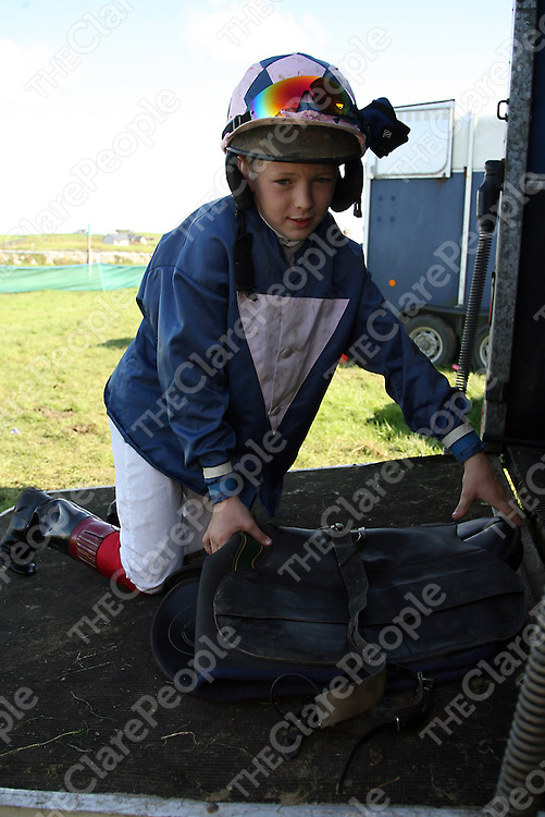 Colin Keane gets his saddle ready at the annual Lisdoonvarna races at the weekend.<br /> Photograph by Yvonne Vaughan