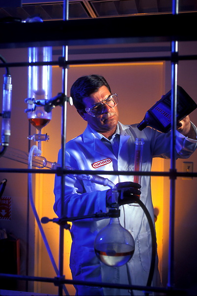 Stock photo of a scientist at Conoco measuring and testing liquids