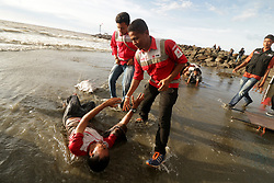 September 7, 2017 - Banda Aceh, Aceh, Indonesia - Students in the province of Aceh, Indonesia, took a theatrical action to defend the Rohingya Muslim minority. In the action, students demonstrate Myanmar military violence against the Rohingya minority that causes them to flee to other countries...Theatrical action taking place on the seafront describes Rohingya refugees who were stranded in Aceh by mid 2015. They were rescued by Acehnese fishermen after being oscillated in the sea after an escape from their country. (Credit Image: © Abdul Hadi Firsawan/Pacific Press via ZUMA Wire)