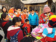 ZHENGZHOU, CHINA - FEBRUARY 18: (CHINA OUT)<br />  <br /> Woman Raises Dolls As Own Kids <br /> <br /> A doll is dressed by an octogenarian female who raises the dolls as her own kids at a park on February 18, 2016 in Zhengzhou, Henan Province of China. The grandma who didn\'t like to be accompanied with her children has been taking three dolls as own kids for eight years. She bought the dolls clothes, took them to do exercises and always spoke to them. <br /> ©Exclusivepix Media