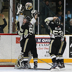 TRENTON, ON  - MAY 6,  2017: Canadian Junior Hockey League, Central Canadian Jr. &quot;A&quot; Championship. The Dudley Hewitt Cup Championship Game between Trenton Golden Hawks and Georgetown Raiders.   Mac Lewis #91 hugs Chris Janzen #1 of the Trenton Golden Hawks after winning the 2017 Dudley Hewitt Cup  <br /> (Photo by Alex D'Addese / OJHL Images)