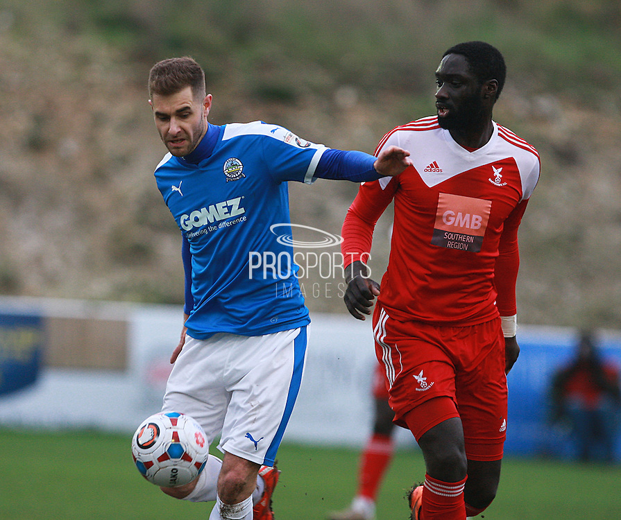 Dover midfielder Nicky Deverdics shields the ball from Whitehawk midfielder Arnaud Mendy during the FA Trophy match between Whitehawk FC and Dover Athletic at the Enclosed Ground, Whitehawk, United Kingdom on 12 December 2015. Photo by Bennett Dean.