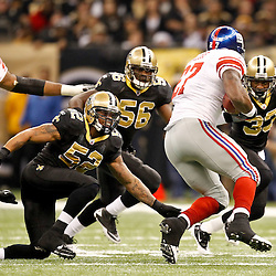 November 28, 2011; New Orleans, LA, USA; New Orleans Saints linebacker Jonathan Casillas (52), linebacker Jo-Lonn Dunbar (56) and cornerback Jabari Greer (33) pursue New York Giants running back Brandon Jacobs (27) during the second half of a game at the Mercedes-Benz Superdome. The Saints defeated the Giants 49-24. Mandatory Credit: Derick E. Hingle-US PRESSWIRE