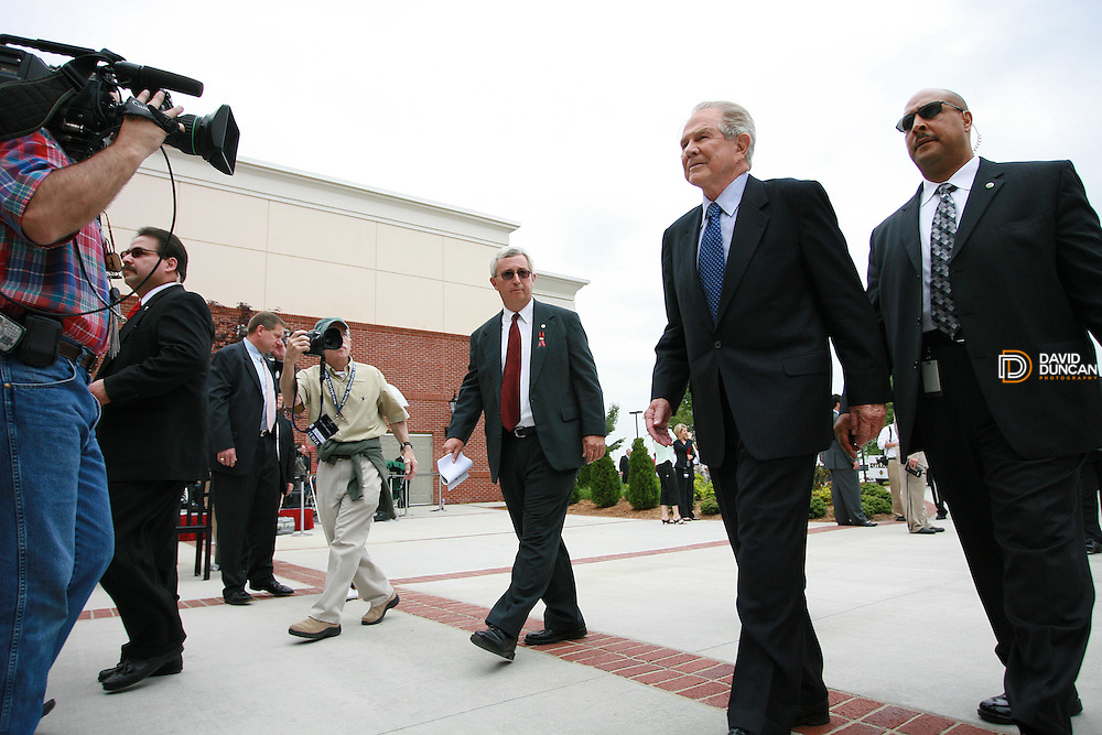 Founder of the 700 club, Pat Robertson, is lead by security into Thomas Road Baptist Church Tuesday May 22nd, 2007.  Thousands of mourners came out to pay their respects at Thomas Road Baptist Church were the Rev. Jerry Falwell's funeral was being held..Photo by David Duncan.