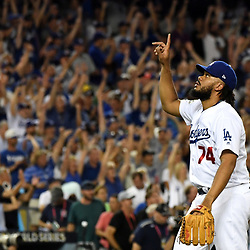 Los Angeles Dodgers relief pitcher Kenley Jansen points to the sky after defeating the Houston Astros 3-1 during game one of a World Series baseball game at Dodger Stadium on Tuesday, Oct. 24, 2017 in Los Angeles. (Photo by Keith Birmingham, Pasadena Star-News/SCNG)
