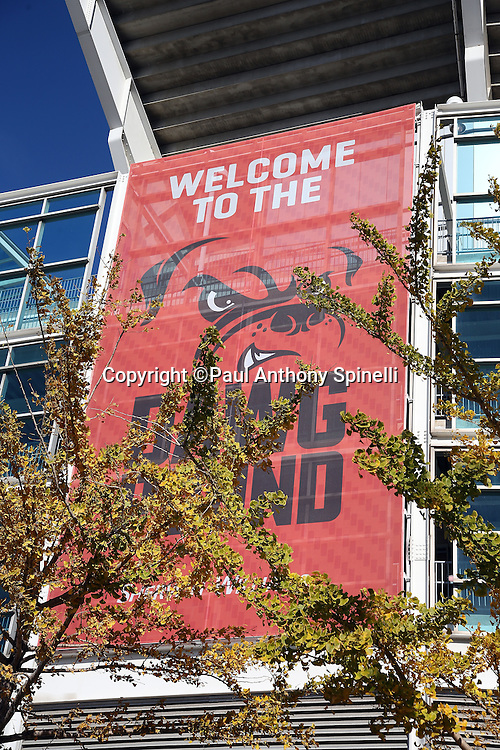 A Welcome to the Dawg Pound logo is pictured on a banner hanging from FirstEnergy Stadium in this wide angle, general view photograph taken before the Cleveland Browns 2015 week 8 regular season NFL football game against the Arizona Cardinals on Sunday, Nov. 1, 2015 in Cleveland. The Cardinals won the game 34-20. (©Paul Anthony Spinelli)