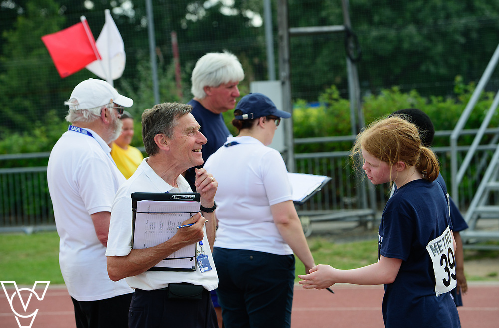 Metro Blind Sport's 2017 Athletics Open held at Mile End Stadium.  4x100m relay.  Chelsea Hudson with official<br /> <br /> Picture: Chris Vaughan Photography for Metro Blind Sport<br /> Date: June 17, 2017