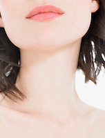 Young Woman Wearing Pink Lipstick close up of neck