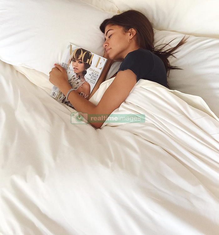 "Zendaya releases a photo on Instagram with the following caption: ""Morning from us\ud83d\ude02\u2728 @voguemagazine"". Photo Credit: Instagram *** No USA Distribution *** For Editorial Use Only *** Not to be Published in Books or Photo Books ***  Please note: Fees charged by the agency are for the agency's services only, and do not, nor are they intended to, convey to the user any ownership of Copyright or License in the material. The agency does not claim any ownership including but not limited to Copyright or License in the attached material. By publishing this material you expressly agree to indemnify and to hold the agency and its directors, shareholders and employees harmless from any loss, claims, damages, demands, expenses (including legal fees), or any causes of action or allegation against the agency arising out of or connected in any way with publication of the material."