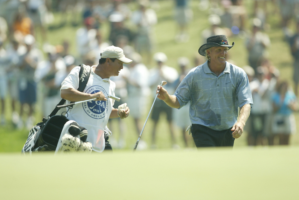 Greg Norman and caddie Tony Navarro..2003 PGA Championship..First Round..Oak Hill CC..Rochester, NY..Thursday, August 14  2003..photograph by Darren Carroll