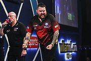 Michael Smith wins the seventh set and celebrates during the World Darts Championships 2018 at Alexandra Palace, London, United Kingdom on 30 December 2018.