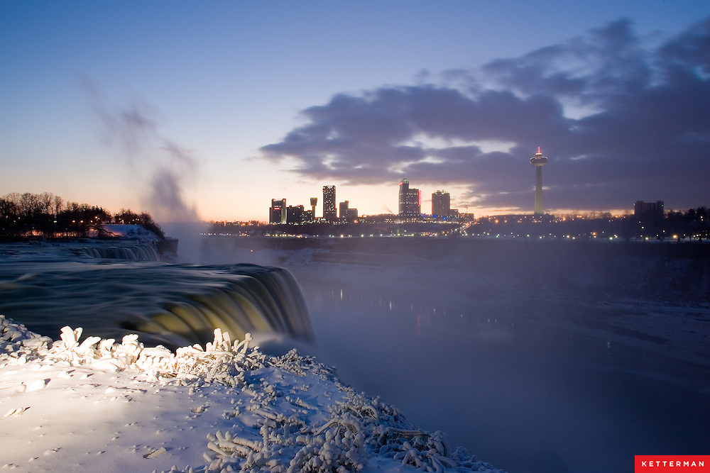 Niagara Falls as seen from the U.S. side in Niagara Falls, New York with Ontario, Canada in the background.
