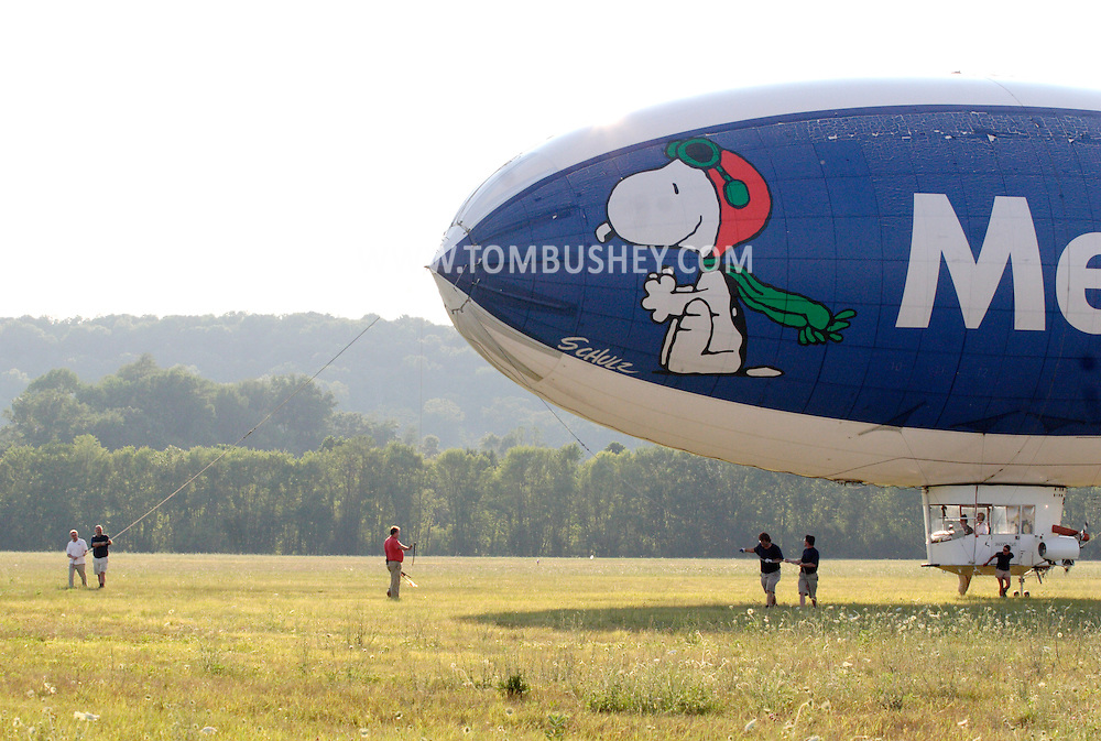 Montgomery, NY - The ground crew helps control the MetLife blimp Snoopy Two as it comes in for a landing at Orange County Airport on July 25, 2008.