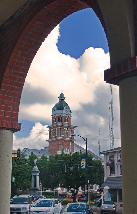 The Lowndes County Courthouse clock tower is framed by the archway of the James M. Trotter Convention Center in Columbus, Miss. Aug. 16, 2010.  (Photo by Carmen K. Sisson/Cloudybright)