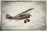1928 Travel Air biplane takes off