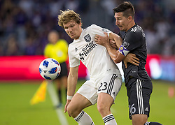 April 21, 2018 - Orlando, FL, U.S. - ORLANDO, FL - APRIL 21: San Jose Earthquakes midfielder Florian Jungwirth (23) and Orlando City midfielder Sacha Kljestan (16) ball for possession during the MLS soccer match between the Orlando City FC and the San Jose Earthquakes at Orlando City SC on April 21, 2018 at Orlando City Stadium in Orlando, FL. (Photo by Andrew Bershaw/Icon Sportswire) (Credit Image: © Andrew Bershaw/Icon SMI via ZUMA Press)