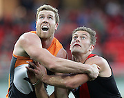 Jonathan Giles of the Giants and Tom Bellchambers of the Bombers during the 2013 AFL Round 17 match between the GWS Giants and the Essendon Bombers at Skoda Stadium, Sydney on July 20, 2013. (Photo: Craig Golding/AFL Media)