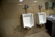 male public toilet urinals with out a separation wall
