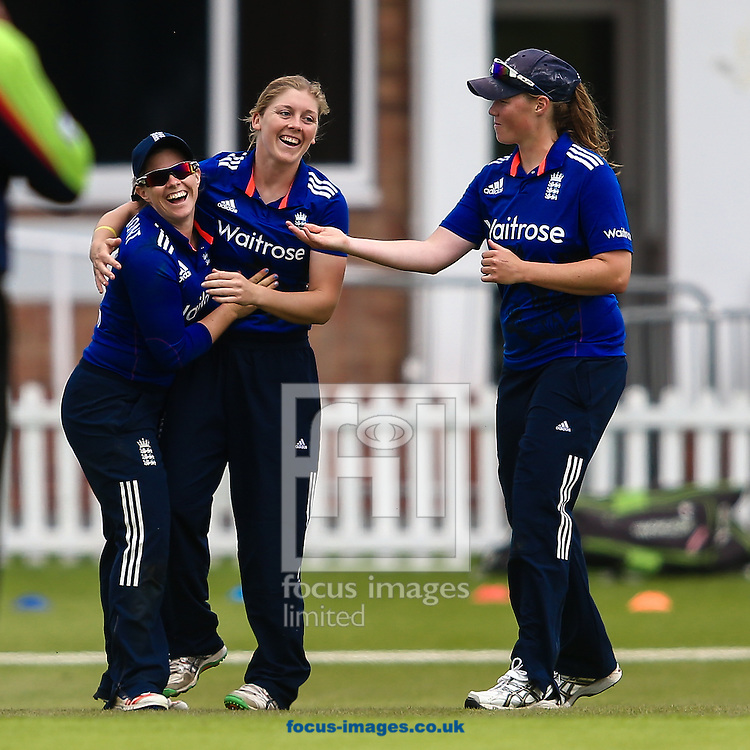 Anya Shrubsole of England (right) celebrates as Heather Knight of England (centre) takes her fifth wicket of the innings dismissing Sania Khan of Pakistan (not shown) caught  by Tammy Beaumont of England (left) during the Royal London One Day Series match at Fischer County Ground, Leicester<br /> Picture by Andy Kearns/Focus Images Ltd 0781 864 4264<br /> 21/06/2016