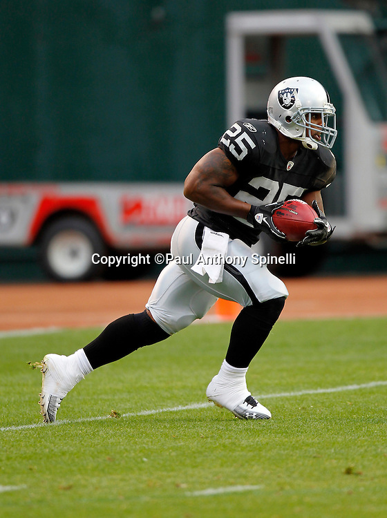 Oakland Raiders kick returner Rock Cartwright (25) returns a kick during the NFL preseason week 3 football game against the San Francisco 49ers on Saturday, August 28, 2010 in Oakland, California. The 49ers won the game 28-24. (©Paul Anthony Spinelli)