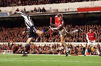 Ray Parlour outjumps Newcastle United defender Aaron Hughes to score his 2nd goal. Arsenal 5:0 Newcastle United, F.A.Carling Premiership, 9/12/2000. Credit Colorsport / Stuart MacFarlane.