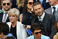 © Licensed to London News Pictures. 02/07/2016. SANDRA GERGiNA WEST and son DAVID BECKHAM watches tennis from the Royal Box on the centre court on the sixth day of the WIMBLEDON Lawn Tennis Championships.  London, UK. Photo credit: Ray Tang/LNP