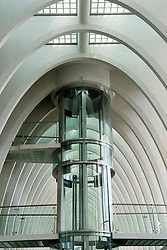 Glass elevator inside new Liège-Guillemins modern railway station designed by architect Santiago Calatrava  in Liege Belgium