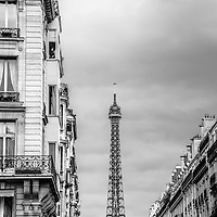 Where: Paris, France. Eiffel tower. I love the 3 simple elements to this image. City street, grey sky, Eiffel tower.
