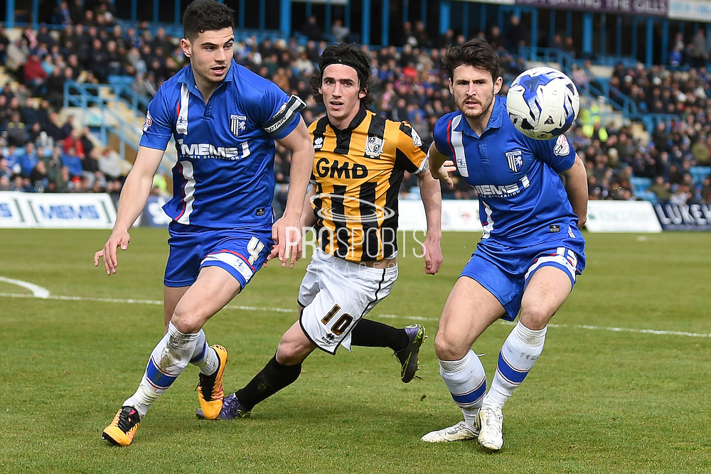 Gillingham defender John Egan, Port Vale midfielder Louis Dodds , and Gillingham defender Aaron Morris during the Sky Bet League 1 match between Gillingham and Port Vale at the MEMS Priestfield Stadium, Gillingham, England on 16 April 2016. Photo by Martin Cole.