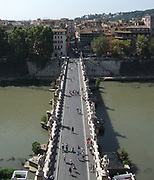 Overhead view of the Ponte Sant'Angelo, (Formerly called the Aelian Bridge) a bridge spanning the Tiber in Rome, Italy. It was completed in 134 AD by Roman Emperor Hadrian, and it links the city centre to his former mausoleum, which is now the Castel Sant'Angelo. the bridge is adorned with colossal statues of angels holding the instruments of passion