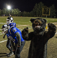 "Winnisquam's ""Bear"" mascot gets the crowd fired up for their Homecoming game against Franklin  under the lights Friday night.  (Karen Bobotas/for the Laconia Daily Sun)"