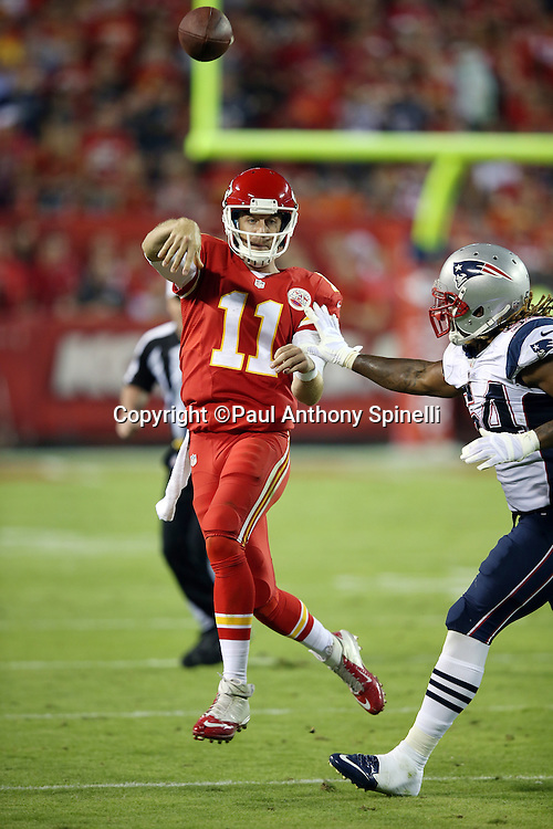 Kansas City Chiefs quarterback Alex Smith (11) rolls right and throws a pass during the NFL week 4 regular season football game against the New England Patriots on Monday, September 29, 2014 in Kansas City, Mo. The Chiefs won the game 41-14. ©Paul Anthony Spinelli