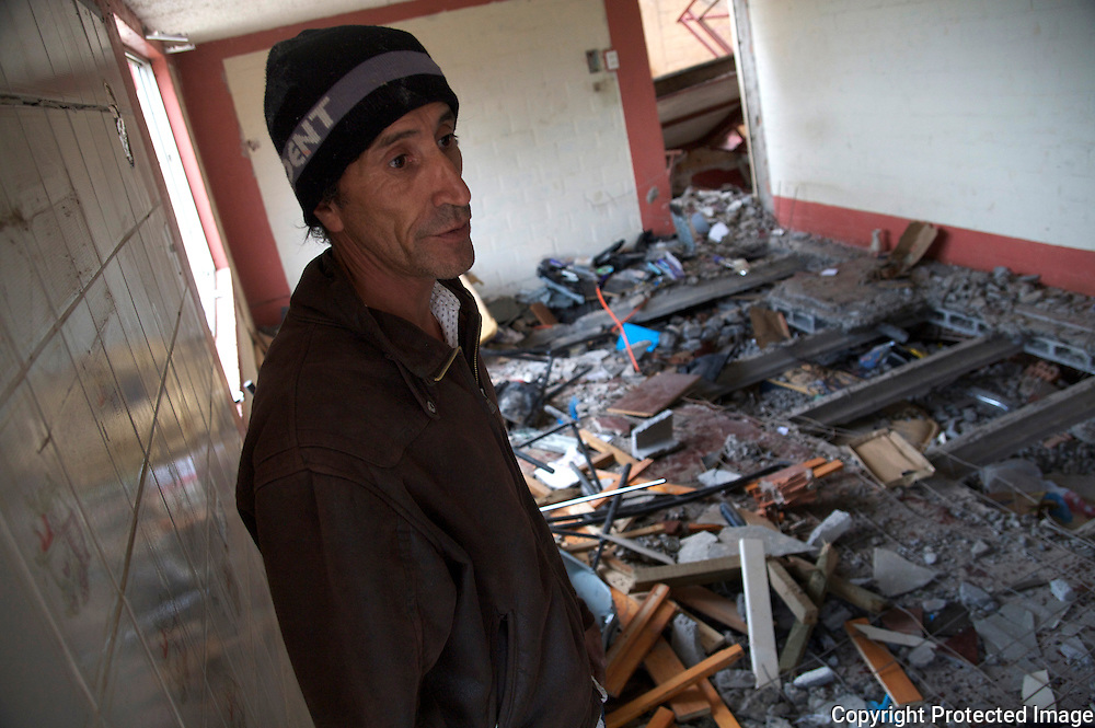 Neighbor of family that died when the apartment building collapsed onto the first floor. He explains that to find the bodies the cement had to be cut on the floor of the second story, which is now the first. 2 families died, 4 adults and 4 children, all sleeping in their beds as the earthquake hit Chile.