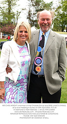 MR CHRIS WRIGHT chairman of the Chrysalis Group and MISS JANICE STINNES, at a race meeting in Surrey on 25th April 2003.	PJD 30