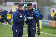 AFC Wimbledon goalkeeping coach Ashley Bayes talking to AFC Wimbledon goalkeeper Nathan Trott (1) during the EFL Sky Bet League 1 match between AFC Wimbledon and Southend United at the Cherry Red Records Stadium, Kingston, England on 1 January 2020.