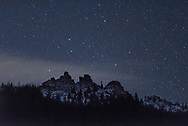 Stars rise above Black Mountain on a cold winter night.