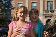 "September 25, 2010 - Reagan Fleser, 10, and Jenna Brown, 10, stop for a moment after cometing in a Whoppie Pie eating contest at the 5th Fluff Fest in Sumerville this past saturday. The girls said that their favorite things about Fluff Fest were ""the sugar and the marsmallow toss."" Photo by Lathan Goumas."