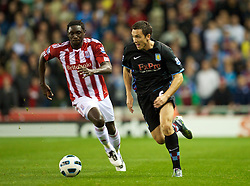 STOKE, ENGLAND - Monday, September 13, 2010: Aston Villa's Stuart Downing and Stoke City's Kenwyne Jones during the Premiership match at the Britannia Stadium. (Photo by David Rawcliffe/Propaganda)