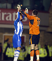 Photo: Chris Ratcliffe.<br />Arsenal v Wigan Athletic. Carling Cup. 24/01/2006.<br />Gary Teale (L) congratulates Mike Pollitt on his penalty save for Wigan.