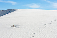 Hiking trail marker buried by sand in White Sands National Monument, New Mexico