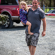 Joel Phoenix, husband of Jessica Phoenix (CAN) with their daughter Jordan at the Red Hills International Horse Trials in Tallahassee, Florida.